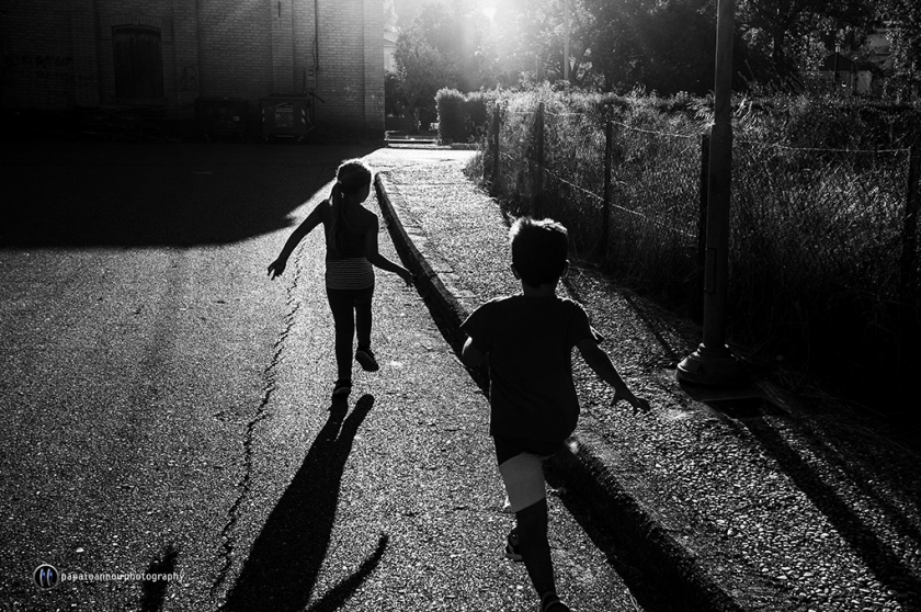 Children running at sunset